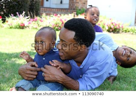 gyönyörű · afroamerikai · család · játszik · kívül · park - stock fotó © feverpitch