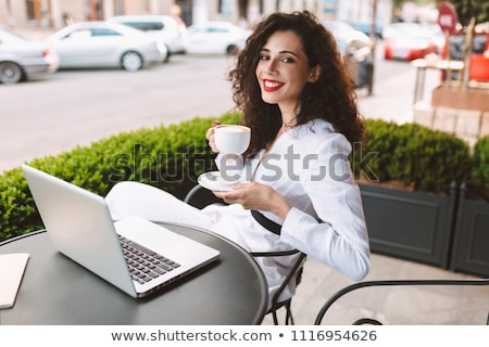 girl with curly hair looking at computer stock photo © photography33