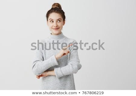 Stok fotoğraf: Gülen · genç · kadın · bakıyor · işaret · beyaz · kadın