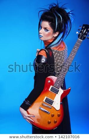 рок девушки позируют электрической гитаре изолированный синий Сток-фото © Victoria_Andreas