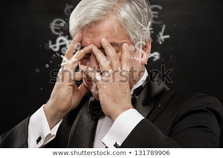 Bad Investment concept. Sad business man with currency symbols. Stock photo © HASLOO