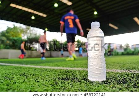 Futballista iszik energiaital fű férfi sport Stock fotó © photography33
