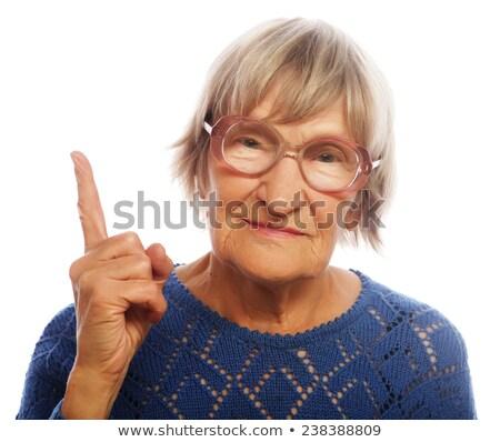 sonriendo · empresarial · mujer · senalando · negocios · mujeres - foto stock © stockyimages