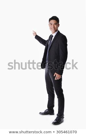 portré · üzletember · mutat · valami · fehér · mosoly - stock fotó © stepstock
