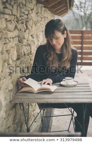 Genç kadın oturma sehpa Stok fotoğraf © Rob_Stark