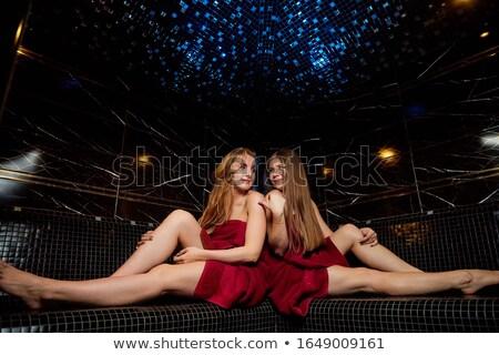 Two female friends in the sauna of a thermal bath Stock photo © Kzenon