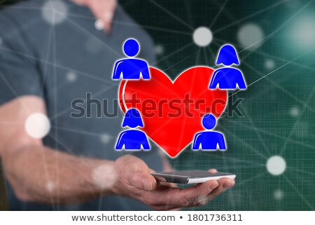 two red hearts held male hands Stock photo © fotoaloja