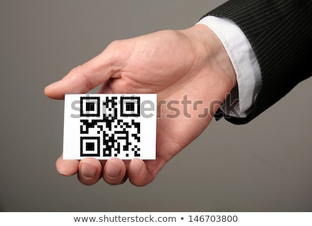 businessman holding qr code business card stock photo © stevanovicigor