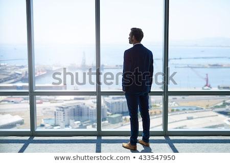 business man looks away stock photo © feedough