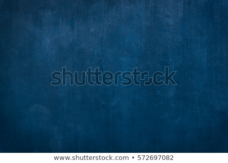 Worn blue paint texture in old stone wall.  Stock photo © Photooiasson