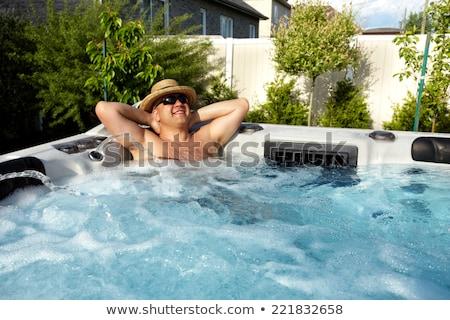ストックフォト: 男 · マッサージ · 温水浴槽 · スパ · ジャグジー · 水