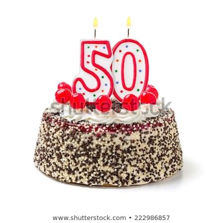 Birthday cake with burning candle number 50 Stock photo © Zerbor