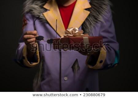 Onherkenbaar clown man christmas geschenkdoos zwarte Stockfoto © HASLOO