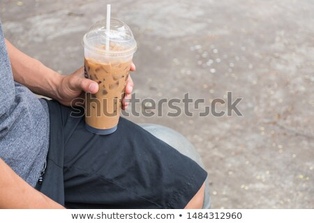 Pastic glass of iced coffee cappuccino Stock photo © nalinratphi