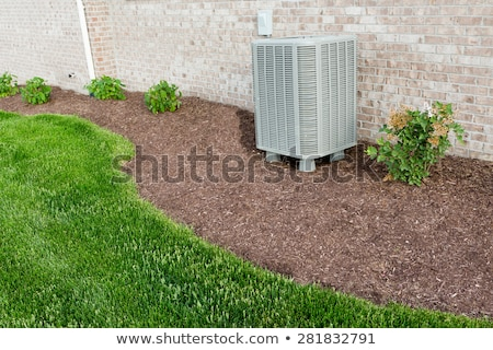 Air conditioner condenser unit standing outdoors Stock photo © ozgur
