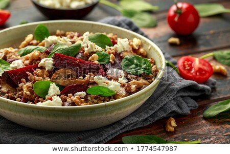 Bowl of porridge with parsley and  walnut Stock photo © fanfo