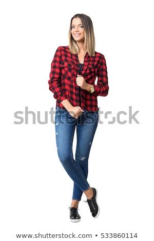 Femme à carreaux shirt femme souriante verres pointant Photo stock © deandrobot