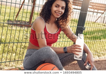 sitting woman with bottle of water stock photo © phbcz