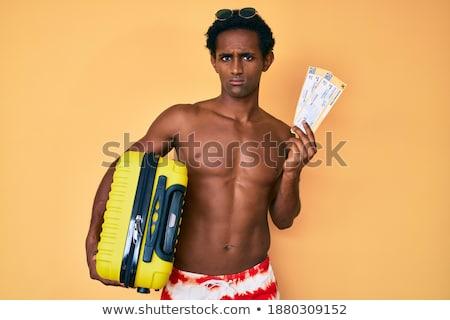 african confused traveler shrugging shoulders stock photo © rastudio