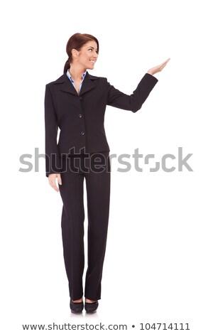 Egészalakos kép mosolyog fiatal nő bemutat ruha Stock fotó © feedough
