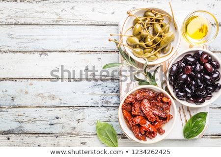 green and black olives with capers and caper berries Stock photo © Digifoodstock