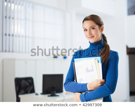 woman looking to camera holding files Stock photo © IS2