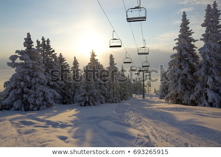 Chair-lift at ski resort and blue clear sky Stock photo © BSANI