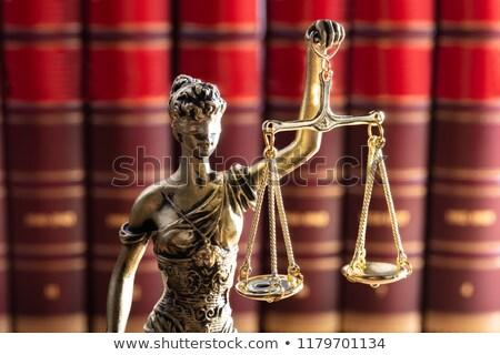 Igazság szobor piros törvény könyvek arany Stock fotó © AndreyPopov