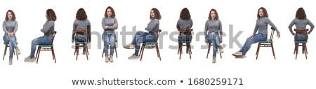 woman back sitting on a chair stock photo © studiostoks