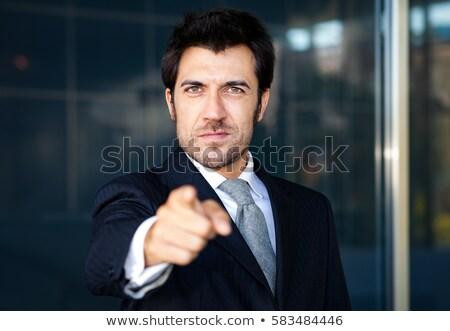 Accueillant affaires pointant doigt affaires main Photo stock © Minervastock