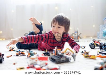 портрет мальчика игрушку рук улыбка глазах Сток-фото © g215