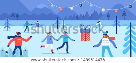 ice rink and winter park people skating outdoors stock photo © robuart