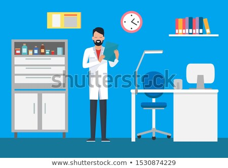 veterinary clinic doctor in gown examining case stock photo © robuart