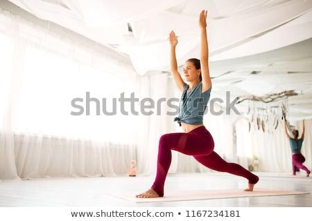 woman making high lunge exercise at yoga studio Stock photo © dolgachov