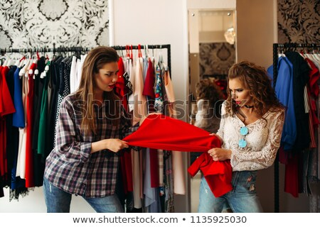 Mulheres um vestido vermelho mãos juntos Foto stock © studiolucky