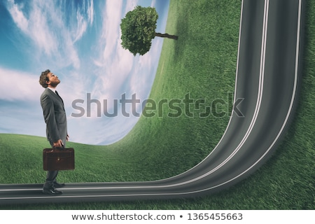 Businessman observes the road uphill in front of him. Achievement business goal and difficult career Stock photo © alphaspirit
