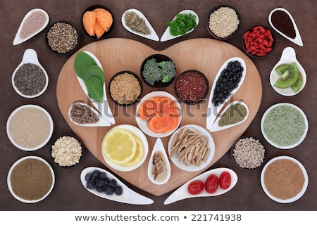 Flax seeds in heart shape bowl foto stock © furmanphoto