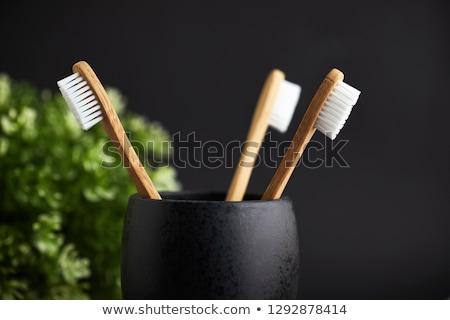 Bambu diş fırçası siyah bez Stok fotoğraf © AndreyPopov
