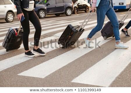 Cropped image of three women walking across pedestrian crossing, Stock photo © deandrobot