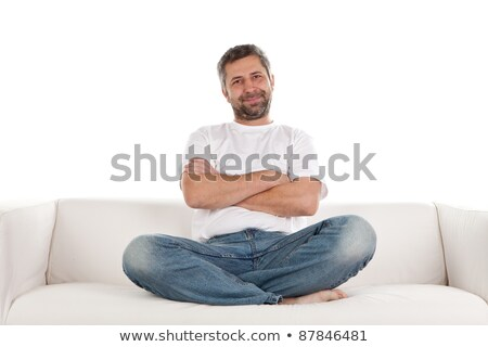 Man Relaxing On Sofa With His Legs Stock photo © AndreyPopov