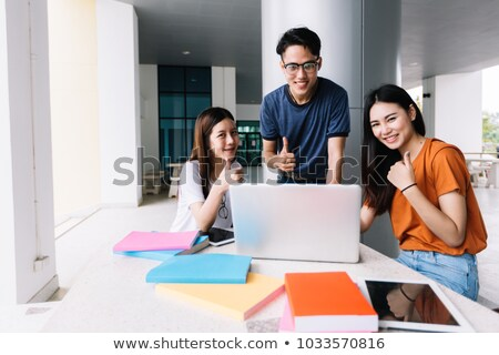 Teen group using computer and tablet to learning online. stock photo © ijeab