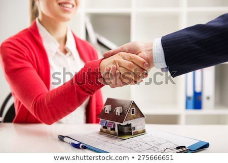 Home loan insurance concept, broker agent shaking hands with cus Stock photo © Freedomz