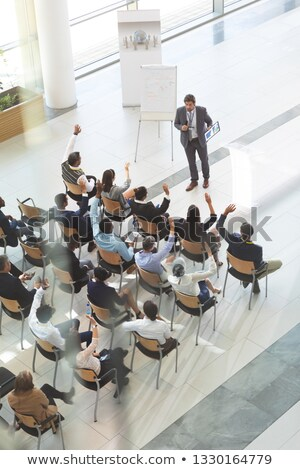 High angle view of middle-aged Caucasian businessman answering question of group of diverse business Stock photo © wavebreak_media