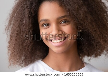 Close up shot of happy dark skinned Afro American woman laughs positively, being in good mood, dress Stock photo © vkstudio
