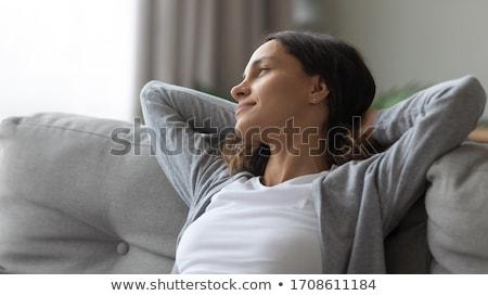 Fiatal nő ül nap bent társalgó csinos Stock fotó © Giulio_Fornasar