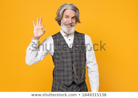 Elderly grey-haired bearded man showing okay gesture. Stock photo © deandrobot