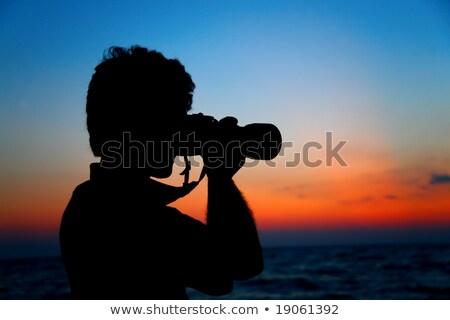 Silhouette of photographer ashore on sunset Stock photo © Paha_L