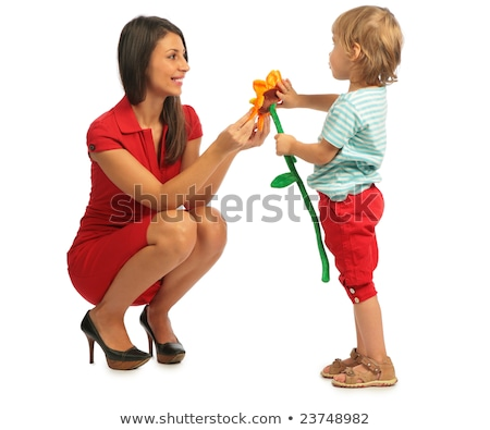 Little girl offer a plush flower to the woman Stock photo © Paha_L