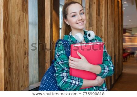 Aranyos fiatal női diák tart mappa Stock fotó © williv