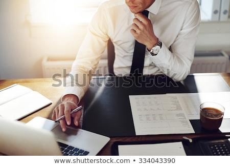 Iş adamı kalem borsa tahta Stok fotoğraf © pongam